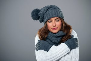 woman-shivering-in-winter