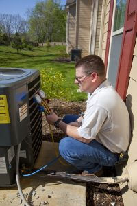 technician-checking-on-ac-pressure